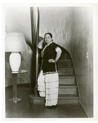 Helena Rubinstein on foot of stairs in tiered pants and embroidered robe, early 30s en verso in pencil