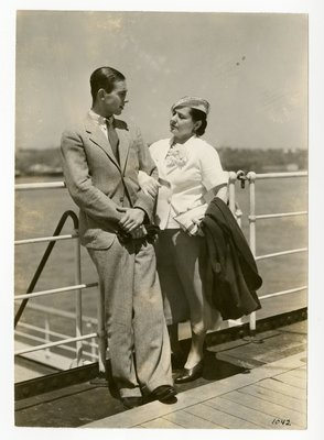 Helena Rubinstein on deck of ship with Roy Titus