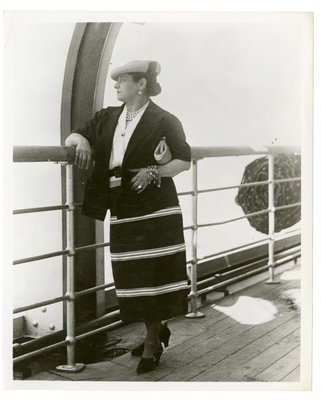 Helena Rubinstein in suit dress on ship deck