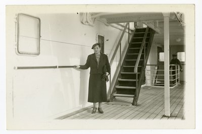Helena Rubinstein holding railing on ship deck