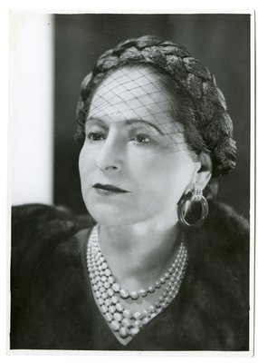 Helena Rubinstein in fur with braided trompe l'oeil hat