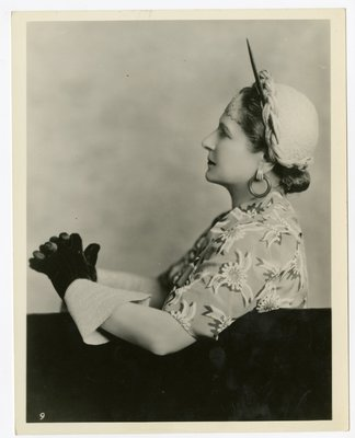 Helena Rubinstein in braided trompe l'oeil hat