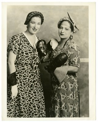 Helena Rubinstein holding primitive art with woman