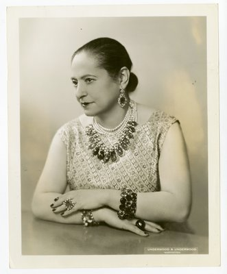 Helena Rubinstein in  ensemble with diagonally striped woven floral design