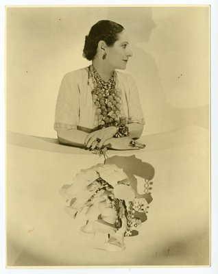 Helena Rubinstein photographed by Cecil Beaton wearing black and white pearl necklaces