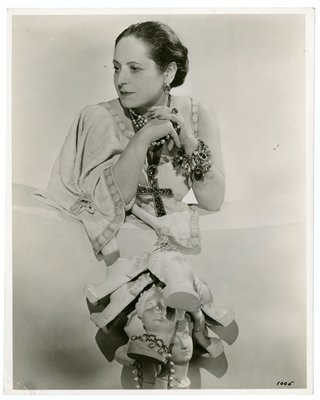 Helena Rubinstein photographed by Cecil Beaton wearing crucifix necklace