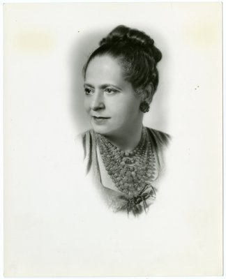 Helena Rubinstein in oval portrait with hair in up-do