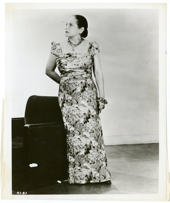 Helena Rubinstein in Schiaparelli floral dress with puffed cap sleeves