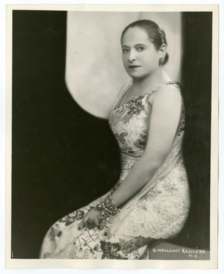 Helena Rubinstein in floral print dress and lace shawl