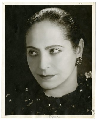Helena Rubinstein wearing dark garment with sequins