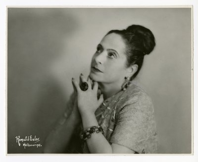 Helena Rubinstein with hands at chin