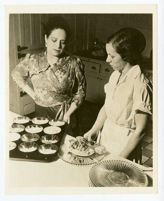 Helena Rubinstein in kitchen with fruited desserts