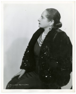 Helena Rubinstein in shimmery cape, V-neck garment