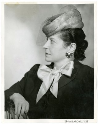 Helena Rubinstein with large bow at neck