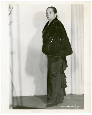Helena Rubinstein in shimmery cape and ruffled skirt