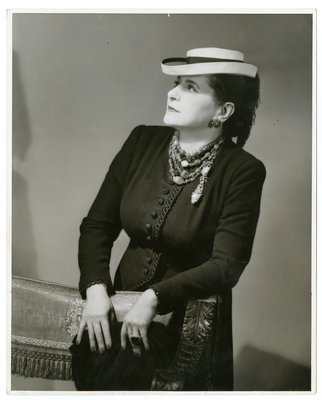 Helena Rubinstein in suit with corded loop embellishment