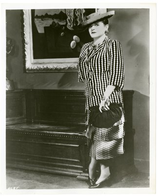 Helena Rubinstein by Dali painting in zigzag print dress