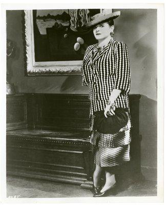 Helena Rubinstein by Dali painting in zigzag print dress