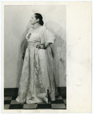 Helena Rubinstein in a silk A-line gown with jewel embellishment