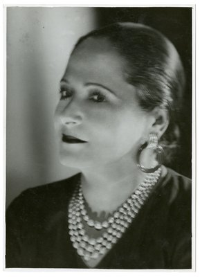 Helena Rubinstein in pearls lit from side and below