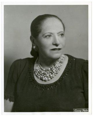 Helena Rubinstein in garment with woven embellishments at neckline
