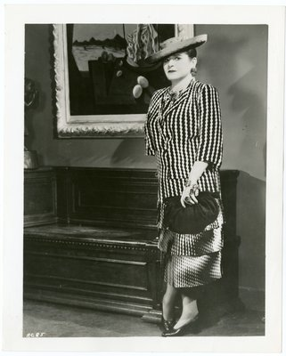 Helena Rubinstein by Dali painting wearing zigzag print