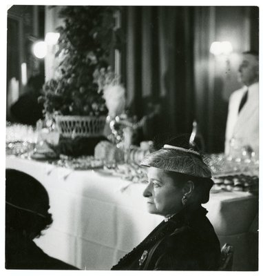 Helena Rubinstein in hat with peacock feather design