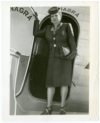 Helena Rubinstein at door of plane during trip to South America