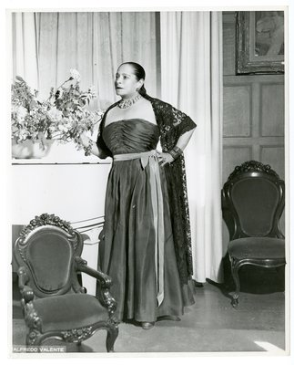 Helena Rubinstein in strapless A-line ruched dress