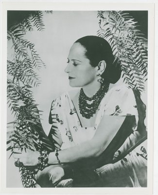 Helena Rubinstein wearing butterfly print dress
