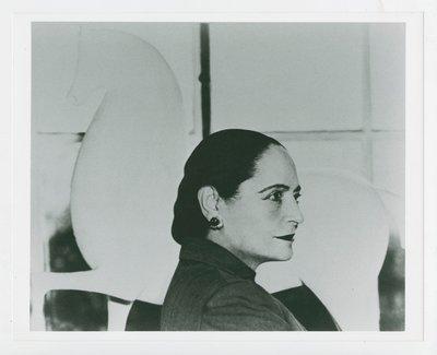 Helena Rubinstein in profile with Nadelman horse sculpture