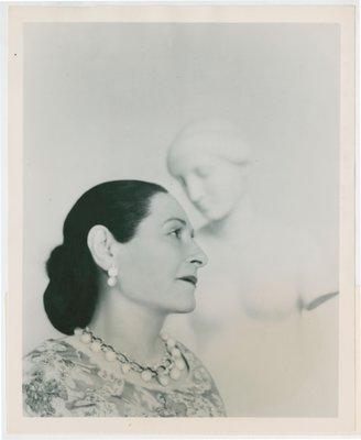 Helena Rubinstein in floral garment with Nadelman sculpture