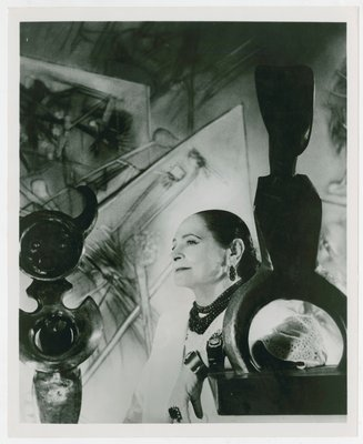 Helena Rubinstein  with sculpture by Max Ernst
