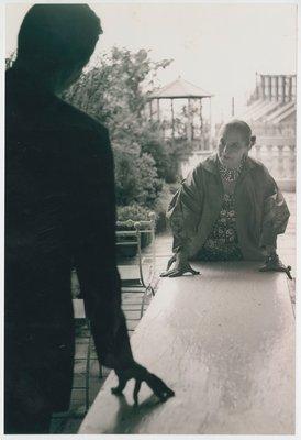 Helena Rubinstein wearing bishop sleeve garment on roof garden