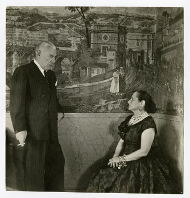 Helena Rubinstein and Artchil Gourielli with mural of townscape