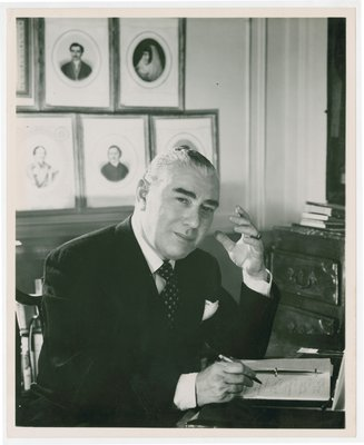 Artchil Gourielli writing at an office desk