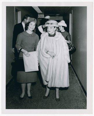 Helena Rubinstein in companions in hallway
