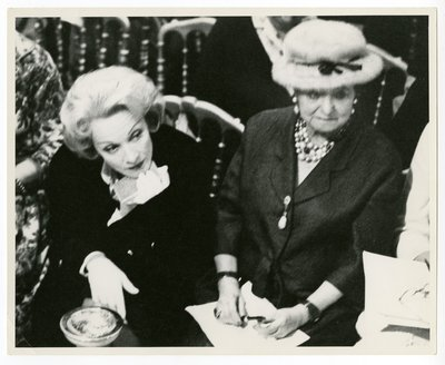 Marlene Dietrich and Helena Rubinstein at a Christian Dior fashion show