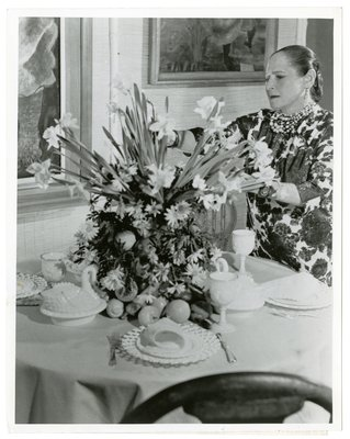 Helena Rubinstein arranging floral display