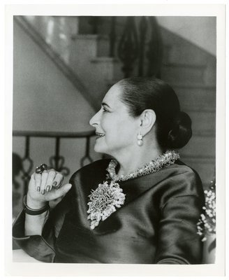 Helena Rubinstein by spiral stairs in her New York apartment