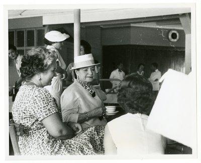 Helena Rubinstein drinking tea at an officers' club in San Juan, Puerto Rico