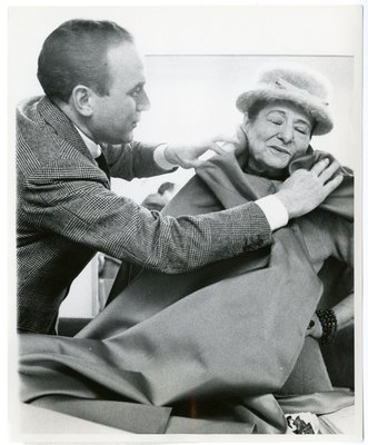 Helena Rubinstein being draped in violet silk