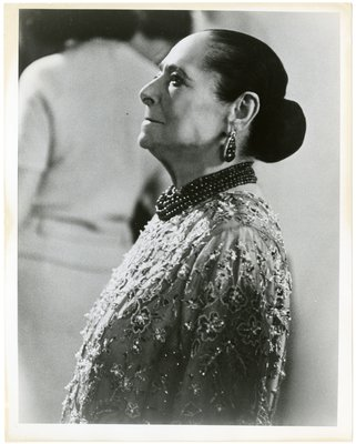 Helena Rubinstein in profile in beaded garment