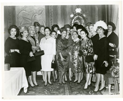 Helena and Mala Rubinstein with sales representatives