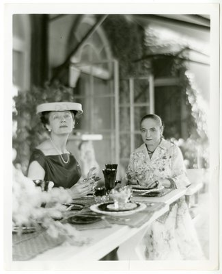 Helena Rubinstein dining with journalist Irene Brin