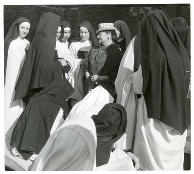 Helena Rubinstein with actors dressed as nuns
