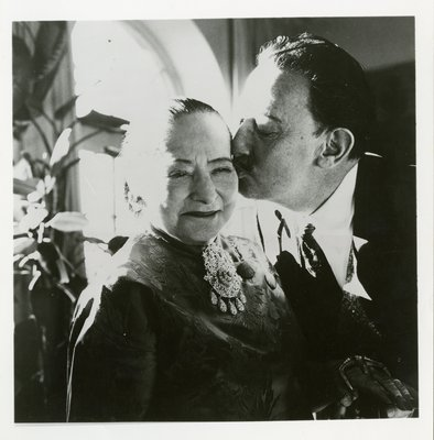 Salvador Dali kissing Helena Rubinstein on the cheek