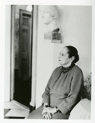 Helena Rubinstein seated below Nadelman sculpture