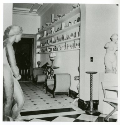 Foyer and hall in the New York apartment, with scultpture and vases