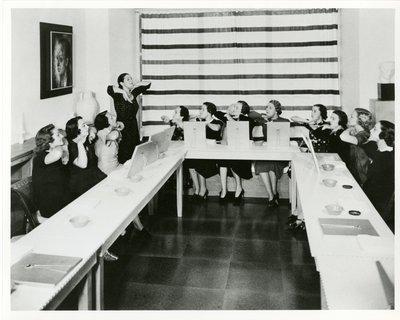 Helena Rubinstein beauty school class in New York, chin exercise